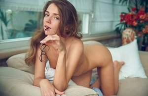 Puny Russian lady Kalisy turns to flaunt her taut ass in the nude