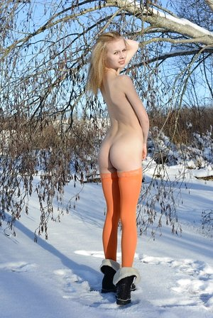 Cold winter day isn't a problem for skinny honey in orange stockings Angelika D