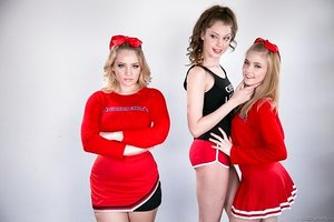 Hot cheerleaders & team captain take it all off for naked post game threesome
