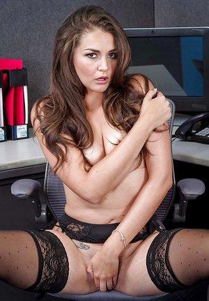 Petite secretary Allie Haze poses in black underwear and pantyhose
