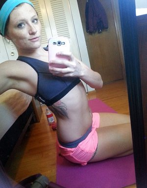 Pierced amateur Freckles takes self shot posing in shorts & sexy panties