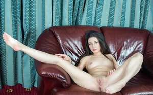 Smiley brunette beauty Lamonica opening up her long legs to expose trimmed cunt