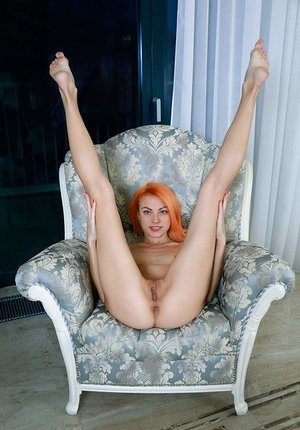 Orange haired Beatrice Roja spreading long legs super wide to display nice pussy