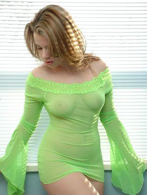 Big titted Kerie Hart in sheer dress flaunting bare round ass in bare upskirt