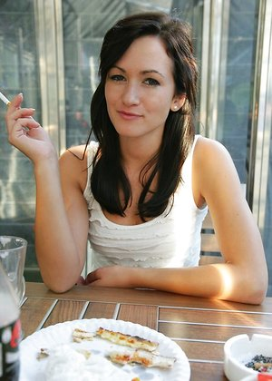 Smoking brunette Tess lifting tight dress on the train for hot naked upskirt