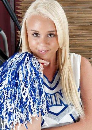 Cute blonde teen Alexis Adams peels off her cheerleader uniform to pose bare