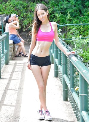 Thin teen lesbians in workout clothes undress outdoors in woods