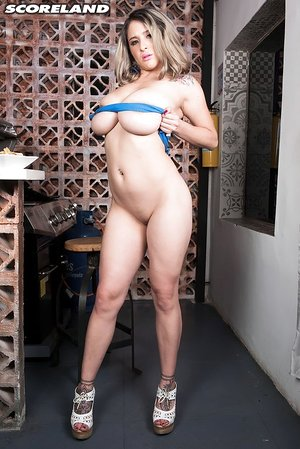 Latina female Katy Shavon uncorks her orbs while doing some grilling