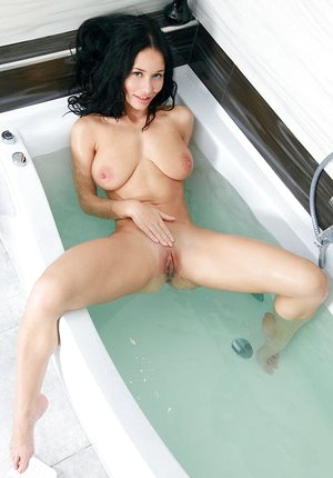 Teen babe Mila M shedding swimsuit in shower to flaunt nice culo