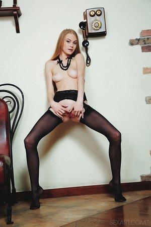 Long legged Nancy A in black stockings spreading long legs & finger fucking