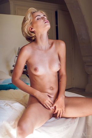 Wonderful blonde Lilit A draining bum naked in her bedroom