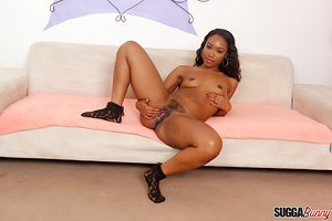Sexy ebony Chanell Heart peels naked to spread nice legs wide wearing socks
