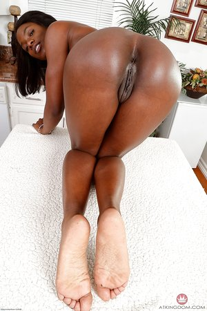 African-American female Ana Foxxx reveals the pink of her trimmed pussy