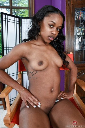 Black teen Amilian Kush grabs hold of her bare ass and parts her pussy