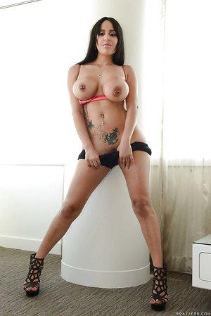 Huge-boobed Latina babe model Kimberly Kendall spreading shaved pussy