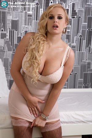 Horny cockslut Angel Wicky lets her huge knockers loose for massager stimulation