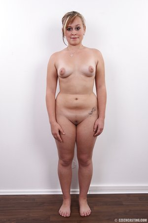 Chubby amateur female stands naked after removing her clothing