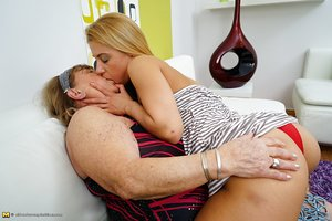 Massive grandmother has lesbian sex with a young looking girl
