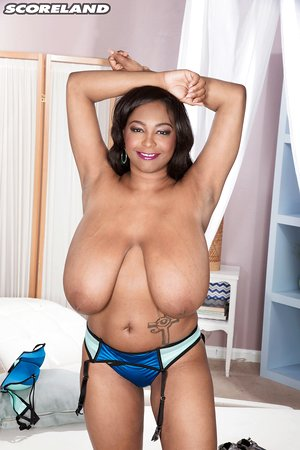 Latina model Rachel Raxxx removing satin brassiere before pawing lotion in knockers