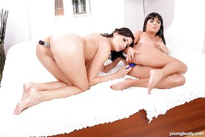 Dark haired teen Ora and her gf please each others pussy with sex toys