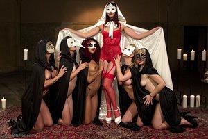 Secret society of Female domination prostate milkers gather en masse in masks and capes