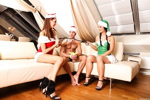 Teen sluts in Christmas costumes share a hard cock of their lewd bf