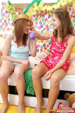 Youthfull girls blow up balloons after their very first lesbian encounter