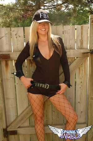 FBI tramp Alicia in fishnet stockings sheds her uniform to pose nude outdoors