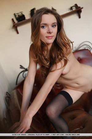 Tiny titted Katie A in black dress flashing naked upskirt wearing stockings