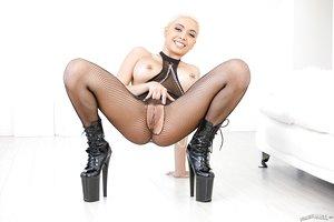 Tart with short blonde hair Aaliyah Hadid in bodystocking and sexy high heels