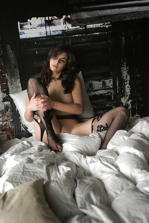 Beautiful solo girl Amelie Belain pulls down the sexiest of ebony stockings