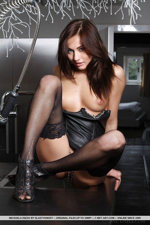 Teen glamour babe Michaela Isizzu modeling in leather and high high-heeled shoes