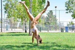 Fit towheaded jogger in short shorts revealing broad open twat in public park