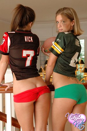 Amateur dykes Karen and Kate have a game of football in knee socks and panties