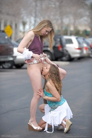 Young sapphic hotties in brief skirts spread ass and eat pussy on the street