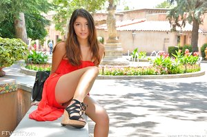 Naughty teen girl Melody-IV flashes her shaved pussy and ass in public