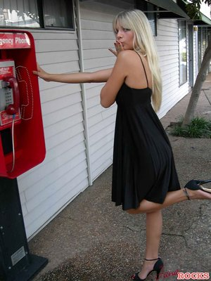 Light-haired inexperienced Jana Jordan flashes her undies at a public phone