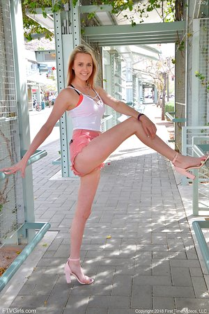 Sweet inexperienced Jody in pink shorts & heels bends to flaunt hot ass in public