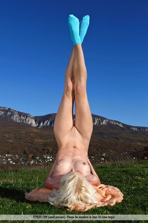 Flexible blond removes hot undies outdoors to contort naked wearing socks