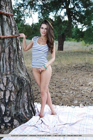 Wonderful teen with a pair of hot breasts Elina shows her meaty cunt outdoors