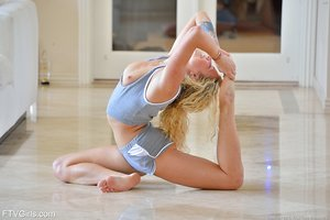 Flexible blonde babe strips down and does some yoga poses in the naked