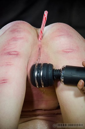 Bare female is restrained and humiliated before forced masturbation