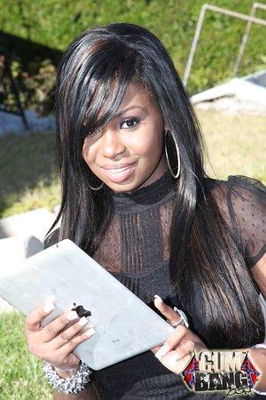 Huge-titted ebony teenage Tatiyana Foxx getting involved in a gangbang with white men