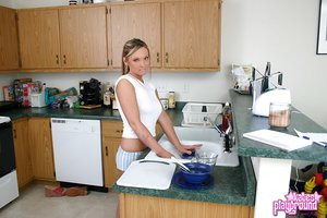 Horny gf wets her white shirt in the kitchen showing her perky tits