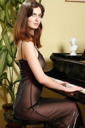 White-hot Czech MILF Charlotta Phillip strips playing the piano
