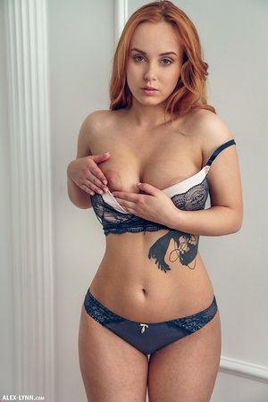 Beautiful redhead Vos holds her firm tits after taking off sensual lingerie