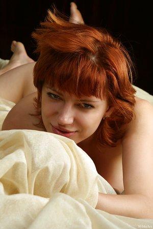 Redhead with fabulous innate boobies Kiara enjoys posing nude in bed