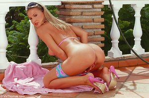 Blonde solo girl Vanesa A dildos her pussy while taking an outdoor shower