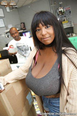 Ebony with huge saggy tits Rachel Raxxx makes white dick jizz in gloryhole room