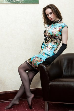 Classy solo model displays her trimmed muff in ebony gloves and stockings
